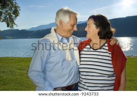 "attractive married mature couple enjoying the sunset. keyword for this collection is ""seniors77"" - stock photo"