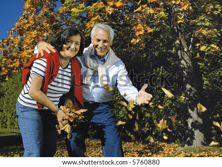 """attractive married mature couple having fun in the park. keyword for this collection is """"seniors77"""" - stock photo"""
