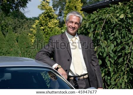 Attractive mature man outside - stock photo