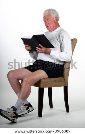 Attractive mature reading a book - stock photo