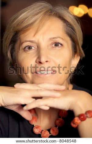 Attractive mature woman looking at camera - stock photo