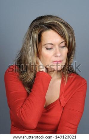 Attractive Mature Woman Rubbing Her Neck - stock photo