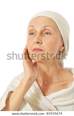 attractive matured woman after bath, on white background - stock photo