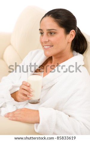 Attractive mid-aged woman drink glass of milk for breakfast - stock photo