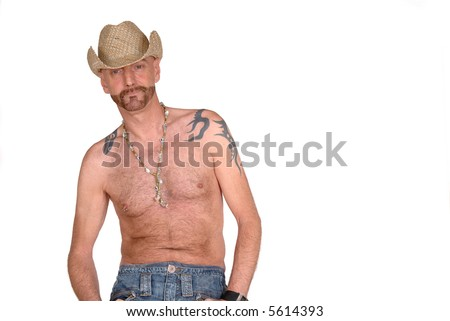 Attractive, mid fifties bearded, man with tattoo wearing hat.  Jeans dressed. Aging beauty, alternative, diversity concept. - stock photo
