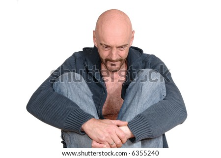 Attractive, mid fifties bearded, meditating middle aged man.  Casual dressed.