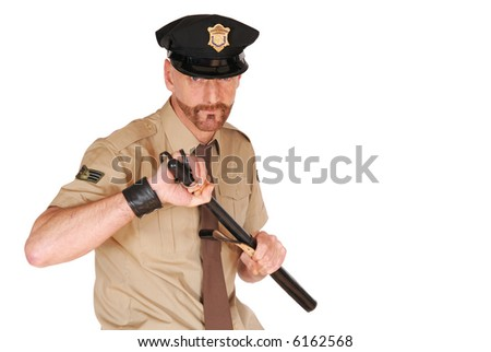 Attractive, mid fifties bearded police officer wearing kepi holding stick, firm expression on face - stock photo