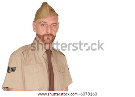 Attractive, mid fifties bearded soldier in uniform - stock photo