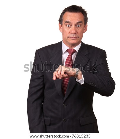 Attractive Middle Age Business Man in Suit Surprised at Time on Watch - stock photo