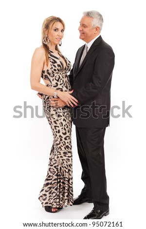 Attractive middle age couple in formal attire on a white background. - stock photo