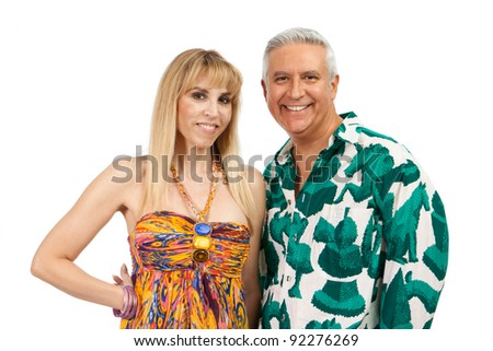 Attractive middle age couple with colorful clothes on a white background. - stock photo