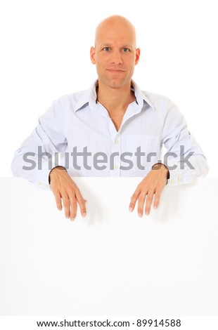 Attractive middle age man behind white wall. All on white background. - stock photo