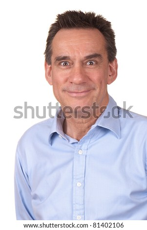 Attractive Middle Age Man in Blue Shirt with Silly Smile and Funny Expression - stock photo
