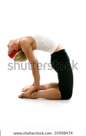 attractive middle age woman exercising and stretching with yoga camel pose