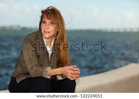 Attractive middle age woman in a urban bay setting.