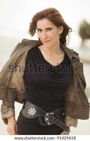 Attractive middle age woman outdoors in a downtown urban bay setting.