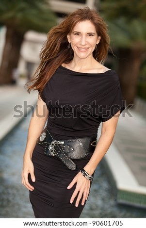 Attractive middle age woman outdoors in a metropolitan urban setting.