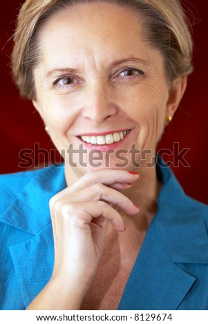 Attractive middle-aged businesswoman looking at camera - stock photo