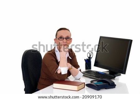 Attractive middle aged businesswoman working in office on computer,  white background,  studio shot.