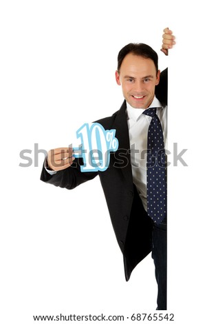 Attractive middle aged caucasian businessman behind a wall showing ten percent discount sign. Copy space. Studio shot. White background. - stock photo