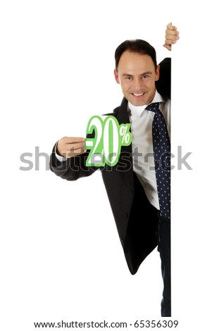 Attractive middle aged caucasian businessman behind a wall showing twenty percent discount sign. Copy space. Studio shot. White background. - stock photo