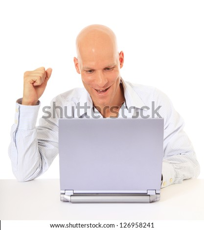 Attractive middle aged man cheering while using laptop. All on white background. - stock photo