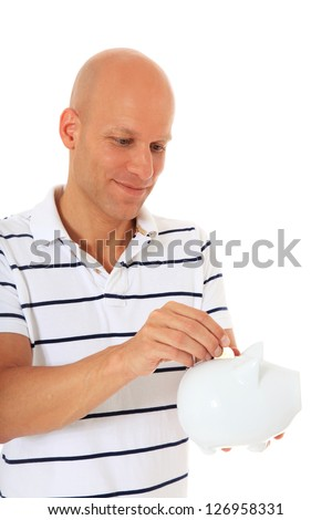 Attractive middle aged man holding piggy bank. All on white background. - stock photo