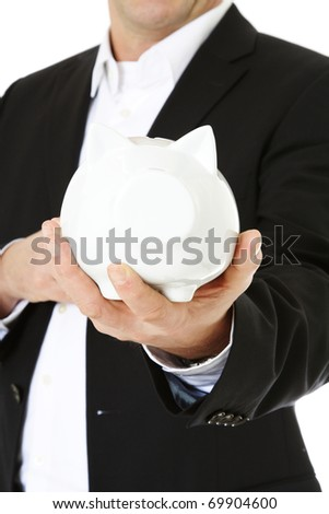 Attractive middle-aged man holding piggy bank. All on white background. - stock photo