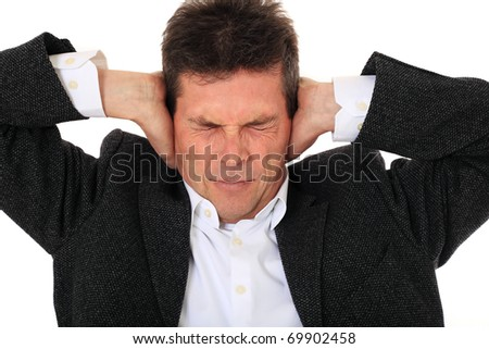 Attractive middle-aged man suffering from headache. All on white background. - stock photo