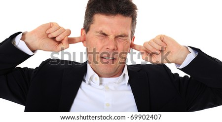 Attractive middle-aged man suffering from tinnitus. All on white background. - stock photo