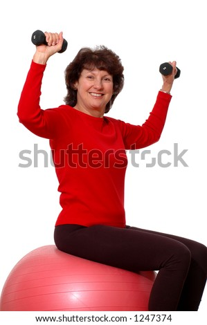 attractive middle aged woman exercising - stock photo