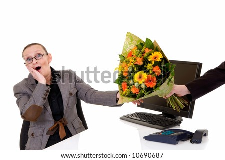 Attractive middle aged woman getting bouquet flowers for birthday, promotion, secretary day,  white background,  studio shot. - stock photo