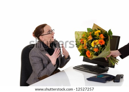 Attractive middle aged woman getting flowers for birthday, promotion, secretary day,  white background,  studio shot. - stock photo