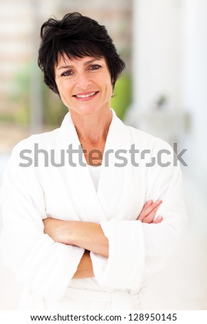 attractive middle aged woman in pajamas at home - stock photo