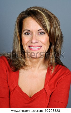 Attractive Middle Aged Woman in Red Sweater - stock photo