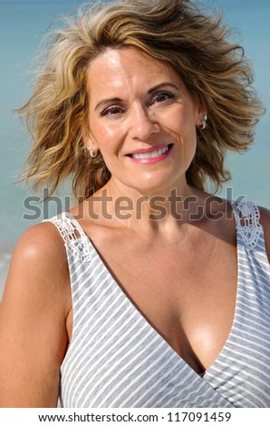 Attractive Middle Aged Woman on the Beach in a Sundress - stock photo
