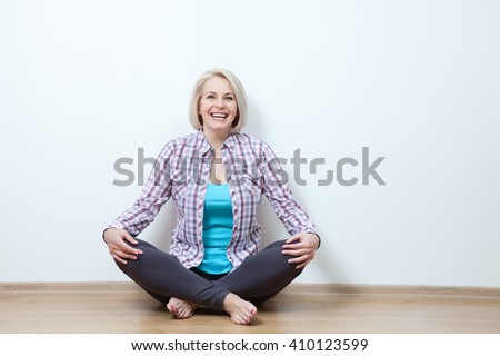 attractive middle aged woman relaxing at home - stock photo