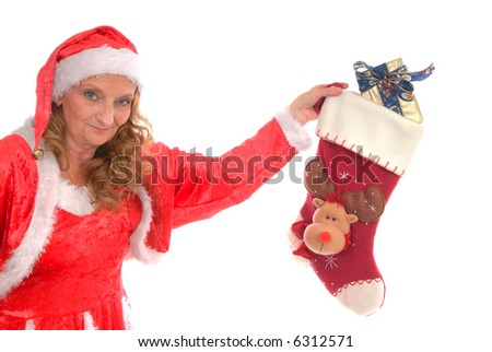 Attractive middle aged woman wearing santa outfit.  White background, copy space