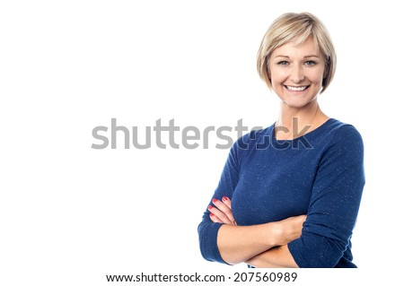 Attractive middle aged woman with folded arms - stock photo