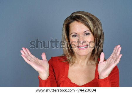 Attractive Middle Aged Woman with Hands Up - stock photo