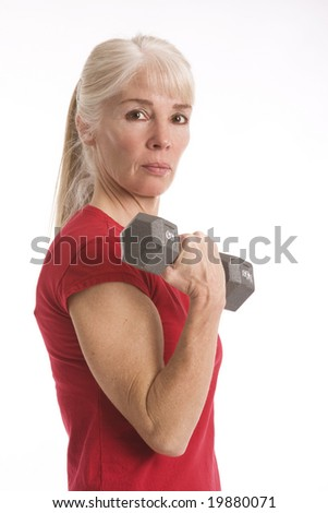 Attractive middle-aged woman working out isolated against white background - stock photo
