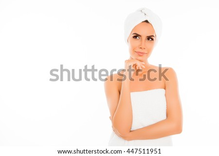 Attractive minded woman in towel after shower on white background - stock photo
