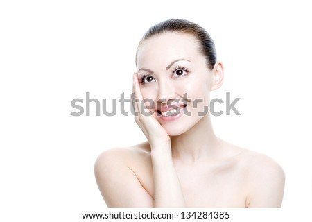 Attractive Mixed Asian Beauty Shot smiling with palm on face - stock photo
