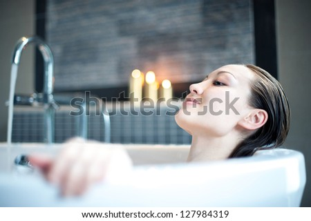 Attractive Mixed Asian Female relaxing in the bath - stock photo