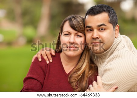 Attractive Mixed Race Couple Portrait in the Park. - stock photo