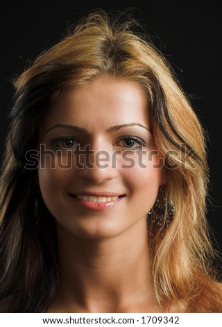 Attractive model face closeup on black background - very high resolution - stock photo