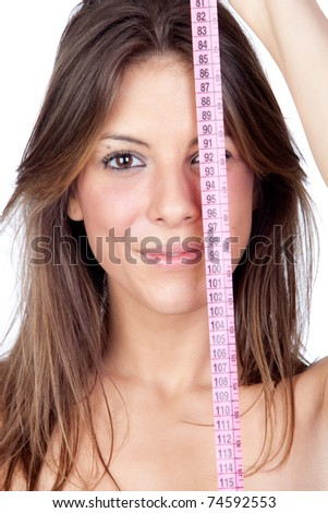 Attractive model girl with a tape-measure isolated on white background - stock photo