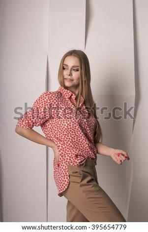 attractive model in a shirt. studio - stock photo