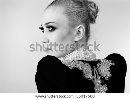 Attractive model in exclusive design clothes on manners old-slavic. Black&White photo. - stock photo