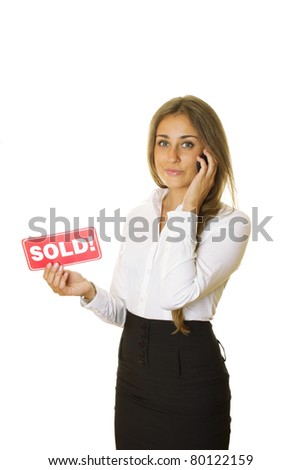 "Attractive modern business woman talking on the phone and keeps the card ""SOLD"" in your other hand. isolated - stock photo"